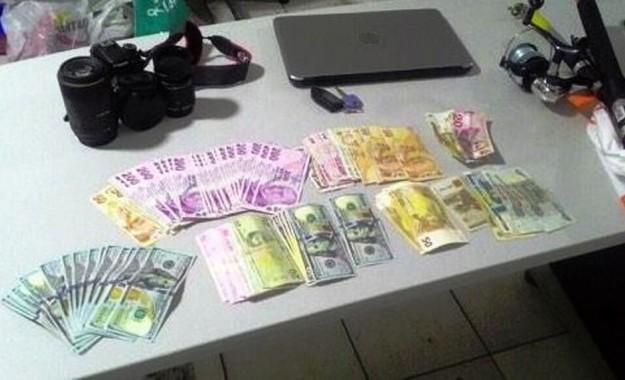 Sinyal kesiciyle otomobilden para çalan hırsızlar yakalandı